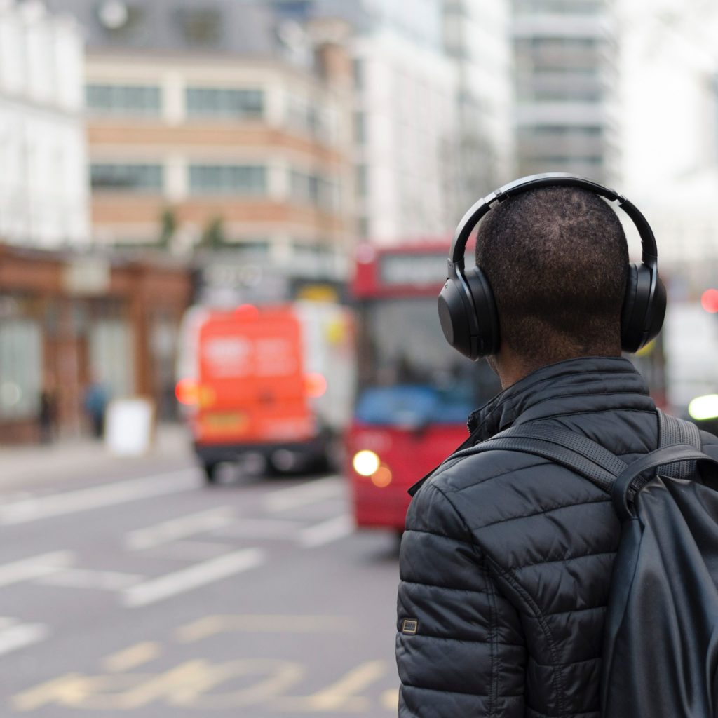 man with a headphone and back turned to us maybe reason to consider renaming podcasts
