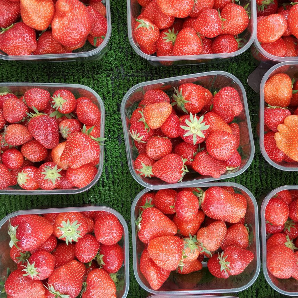 Strawberries in multiple containers