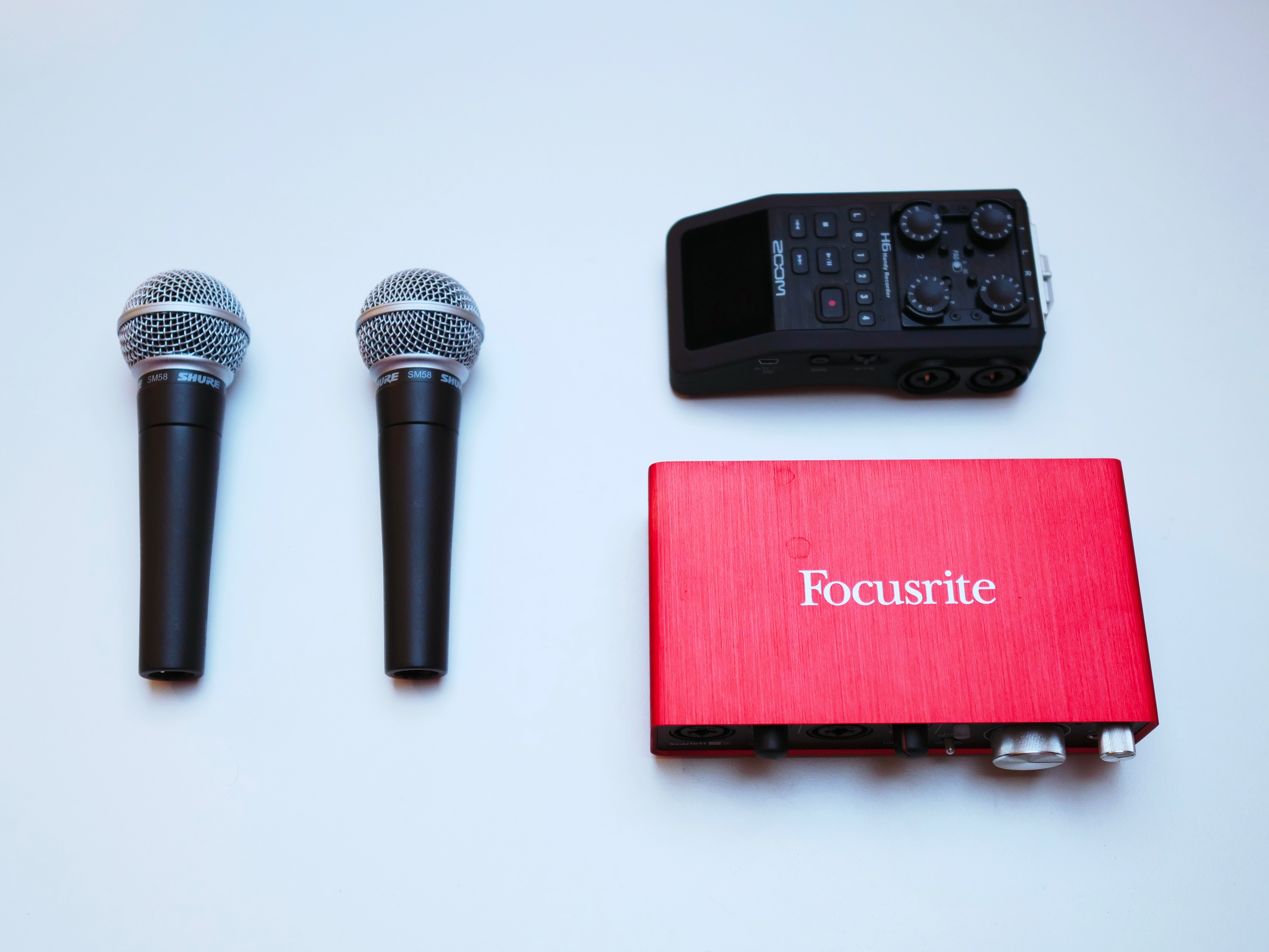 Essential Podcast Recording tools Focusrite Scarlett, 2 Microphones, a Zoom Hand Held Recorder